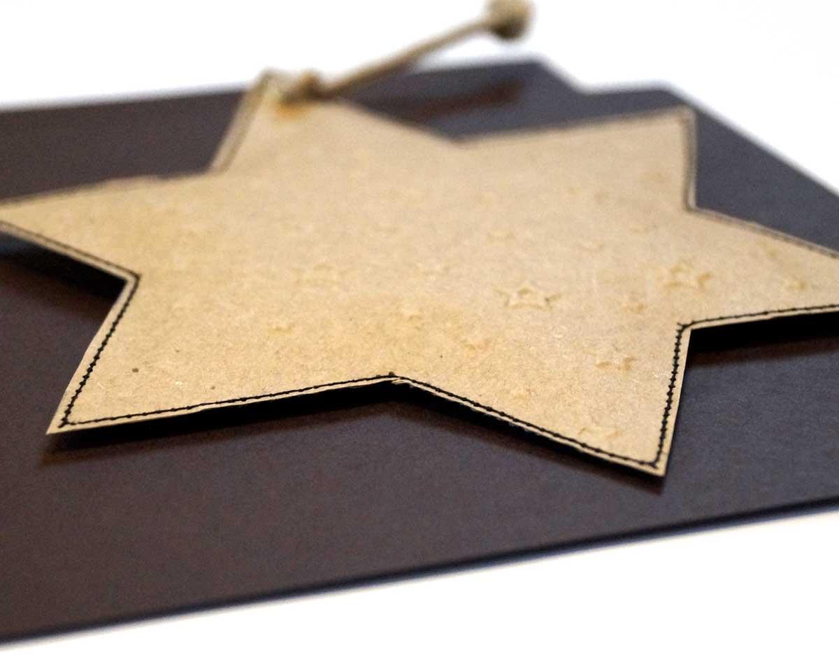 Weihnachtskarte mit abnehmbarem Stern.